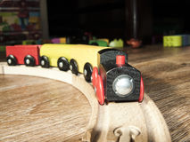 The toy wooden engine with cars. Royalty Free Stock Images