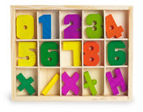 Toy wooden figures in a box Stock Photography
