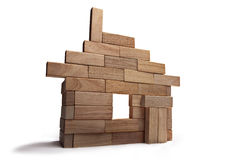Toy wooden house. Layout of the house out of wooden sticks Stock Images