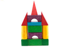 Toy wooden house from coloured blockes isolated on white Stock Photos