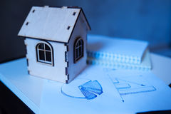 Toy wooden house. Concept Stock Photo