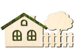 Ecological toy wooden house with the fence isolated on white background. royalty free stock images