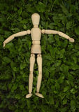 Toy wooden man on grass Royalty Free Stock Photos