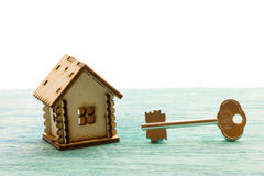 Toy wooden model house as symbol family and love concept  on sunny Stock Photos