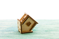 Toy wooden model house as symbol family and love concept  on sunny Royalty Free Stock Photography