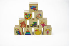 Toy wooden pyramid of blocks with pictures Royalty Free Stock Photo