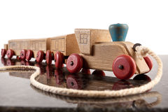 Toy wooden train with string to pull it. Royalty Free Stock Photography