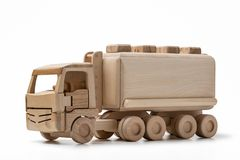 Toy, wooden truck with tank, isolated on white background Royalty Free Stock Photos
