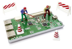 toy workers repairing computer Royalty Free Stock Images