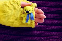 Toy yellow bear in hand. Toy yellow little bear in hand Royalty Free Stock Photo