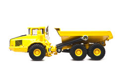 Toy yellow dumper truck. Isolated over white background Royalty Free Stock Image