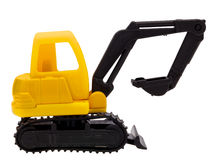 Toy yellow excavator. Toy excavator isolated on white Stock Images