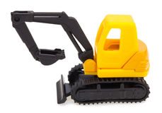 Toy yellow excavator. Toy excavator isolated on white Stock Image
