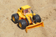 Toy yellow tractor Stock Photography