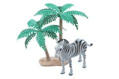 Toy Zebra med träd royaltyfria foton