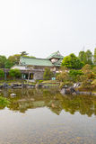 Toyama castle with beautiful garden and reflection in water. royalty free stock images
