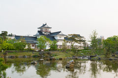 Toyama castle with beautiful garden and reflection in water. Stock Photos