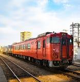 Toyama, Japan - May 11, 2017 : Orange passenger train of JR comp. Any with Ninja Hatori charactor at second bogey Royalty Free Stock Photography