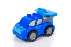 Toybil på vit bakgrund Arkivbild
