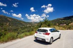 Toyota Auris on the road of Crete island Stock Photos