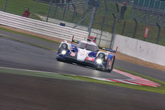 Toyota Through the Bends at Silverstone. Toyota TS040 Hybrid en route to wining the 6 hours of Silverstone royalty free stock photo
