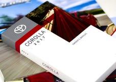 Toyota Corolla-autohandboek Stock Foto