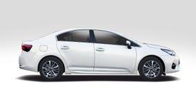 Toyota Corolla på vit royaltyfria bilder