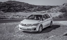 Toyota Corolla. A toned black n white shot of Toyota Corolla 2013 model in a wild landscape background Royalty Free Stock Images
