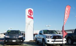 Toyota dealership sign against blue sky. Toyota is the world`s market leader in sales of hybrid electric vehicles. stock photography