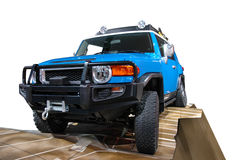 Toyota FJ vehicle isolated on white. A 4x4 Offroad Toyota FJ vehicle isolated on white. Clipping Path on vehicle and obstacle Royalty Free Stock Photo