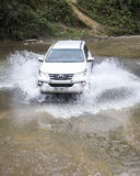 Toyota Fortuner 2017 SUV in a test drive. Lao Cai, Vietnam - Mar 17, 2017: Toyota Fortuner 2017 SUV in a test drive for ability on multi terrains in the far Stock Photo