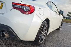 Toyota GT86. A white Toyota GT86 stands by the track, waiting for a spin Stock Image