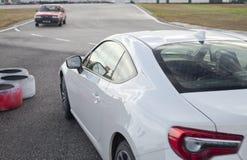 Toyota GT86 y AE86 en pista Fotos de archivo libres de regalías