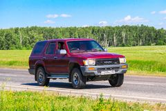 Toyota Hilux Surf. Chelyabinsk region, Russia - July 11, 2016: Motor car Toyota Hilux Surf at the interurban road royalty free stock photos