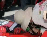 2006 Toyota Indy 300. Actress Ashley Judd kisses her husband Dario Franchitti just prior to the start of the Toyota Indy 300 at Homestead Miami Speedway in stock images