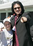 2006 Toyota Indy 300. Gene Simmons of Kiss and Lynne Dee Brewer enjoy a moment in the garage area prior to running the Toyota Indy 300 at Homestead Miami stock photography