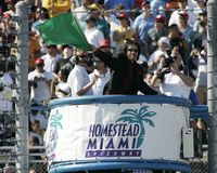 2006 Toyota Indy 300. Honorary starter Gene Simmons waves the green flag starting the Toyota Indy 300 at Homestead Miami Speedway in Homestead, Florida on March stock photography