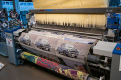 A Toyota JAT710 weaving machine in action. Weaving demonstration at the Toyota Commemorative Museum of Industry and Technology using a Toyota JAT710 machine to Stock Photo