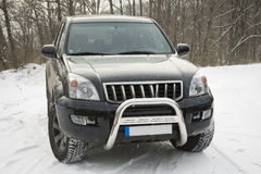 Toyota land cruiser. SUV standing on snowy road in high mountain during a snowfall Stock Photo