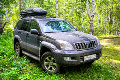 Toyota Land Cruiser Prado 120. CHELYABINSK REGION, RUSSIA - JULY 8, 2017: Black off-road car Toyota Land Cruiser Prado 120 at the countryside Royalty Free Stock Images