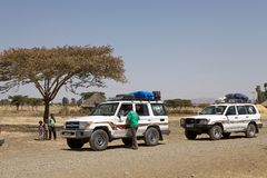 Toyota Land Cruisers on the road. In Ethiopia expedition. Toyota Land Cruisers is a series of four-wheel drive vehicles produced by the Japanese car maker Stock Images