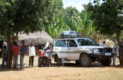 Toyota Land Cruisers on the road. Toyota Landcruiser at the african viillage in rural area. Toyota Land Cruisers is a series of four-wheel drive vehicles Royalty Free Stock Image