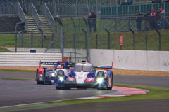 Toyota leads the way at Silverstone. Toyota TS040 Hybrid leads a car through a bend at Silverstone royalty free stock image