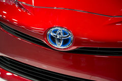 TOYOTA logo. A TOYOTA logo on new red car royalty free stock images