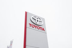 Toyota logo, stand near a car dealership, Toyota advertisement. Logo Toyota Royalty Free Stock Images