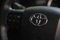 Toyota Logo on steering wheel in New Toyota Hilux Revo Rocco Pickup stock photography