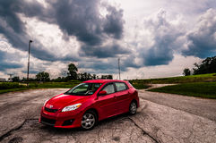 A Toyota Matrix in a old parking lot. stock photos