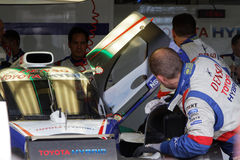 Toyota mechanics in the pits. LE CASTELET, FRANCE, March 28, 2015 : Toyota mechanics during the training sessions for World Endurance Car Championship, before Stock Photos