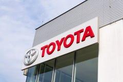 Toyota motor corporation logo on dealership building Stock Photos