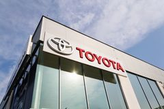 Toyota motor corporation logo on dealership building Royalty Free Stock Images